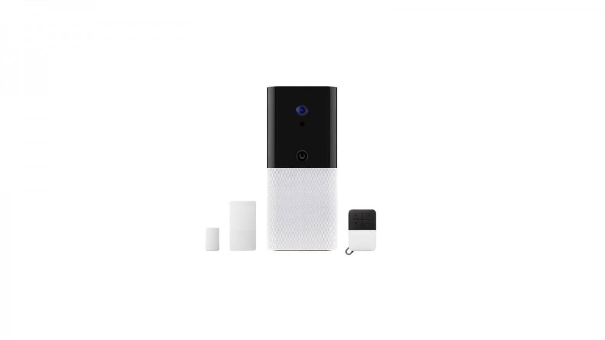 Un concentrateur Abode iota avec porte-clés et capteur de contact.