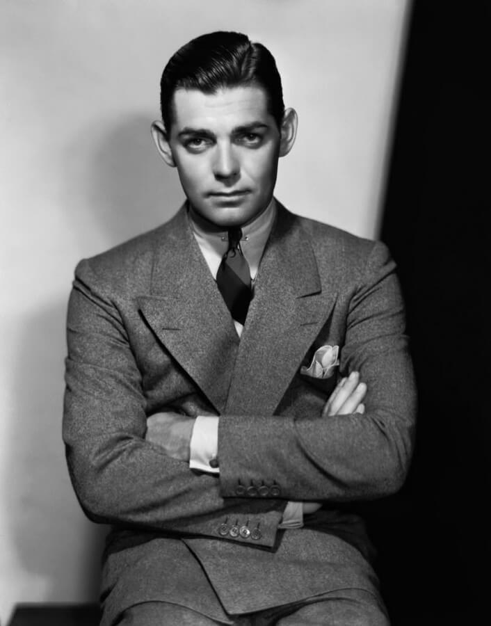 Clark Gable portant un large costume en tweed à revers en pointe