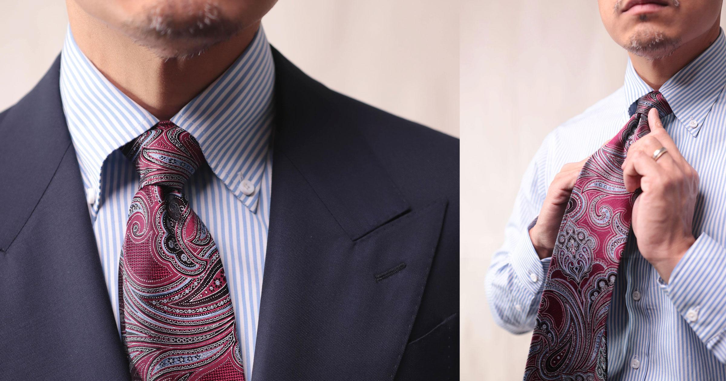 Libre de cravate paisley avec chemise rayée bleue et costume bleu marine