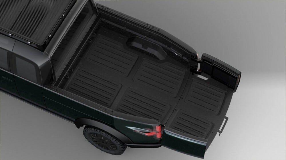 L'arrière d'un pick-up avec un lit allongé